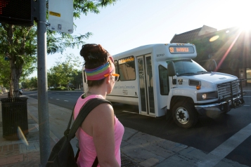 After receiving her methadone dose at a clinic in Bakersfield, Calif., Heather Menzel waits for the bus to take her back home to Lake Isabella on June 6, 2016. The bus ride takes about an hour and goes through a twisty canyon into the Sierra Nevada foothills. (Brian Rinker for KHN)