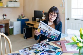 Patricia Martin looks through old photographs of her husband, Robert Martin, on April 14, 2017. Robert, a family practice physician, died from prostate cancer in 2014 in the family home in Wasilla, Alaska. (Heidi de Marco/KHN)