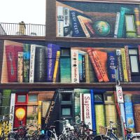 Street Art for Book Lovers: Dutch Artists Paint Massive Bookcase Mural on the Side of a Building | Open Culture